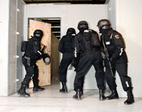 Shooters engaged in Breach door Training