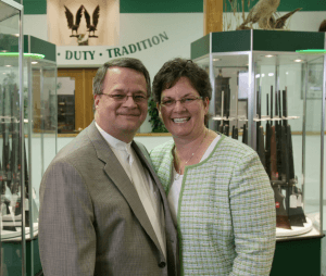 Miles Hall poses with his wife at H&H Shooting Sports in Oklahoma City.